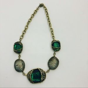 Gold and emerald stone necklace